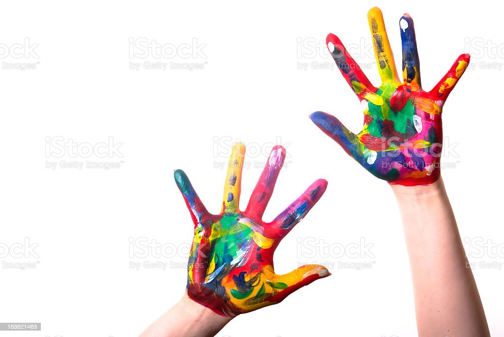 Child's hands covered in multicolored paint on a white back royalty-free stock photo