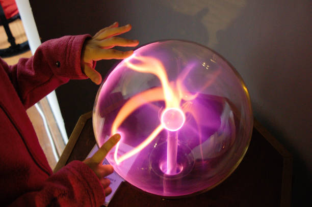 Child's hands on a plasma ball. stock photo