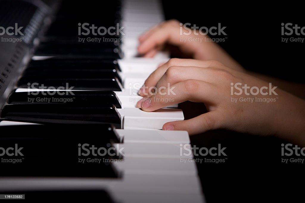 Child's hands playing piano - horizontal royalty-free stock photo