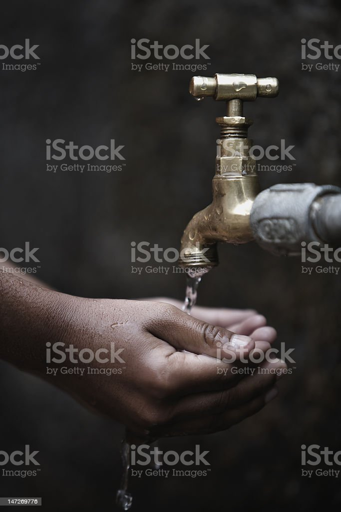 Child's Hands Under Water Tap royalty-free stock photo