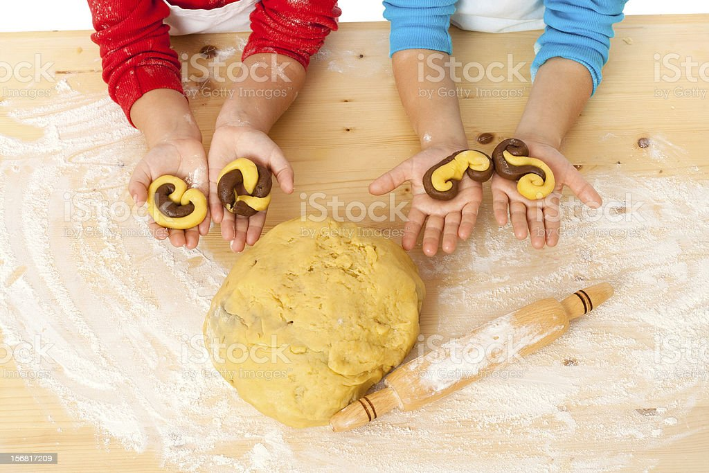 child's hands with dough above the table stock photo