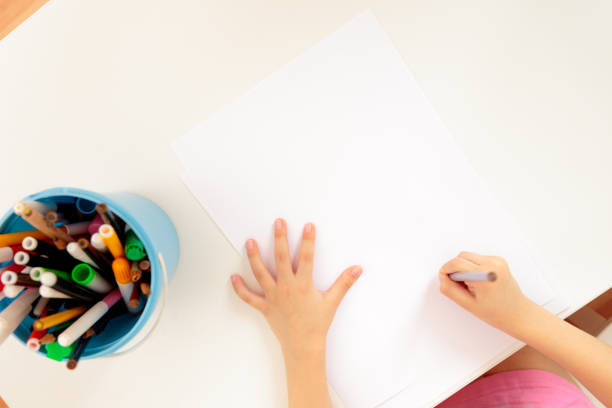 Child's hands with pencil stock photo