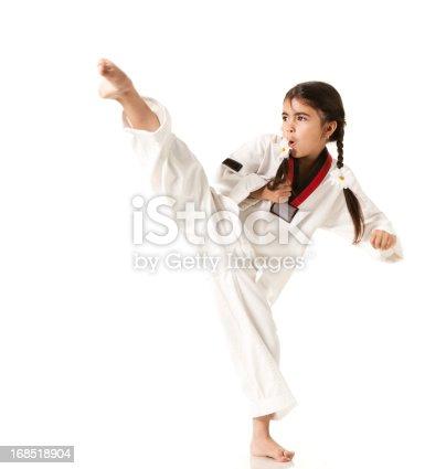 Child practicing Karate on white background, studio shot. Series >>>