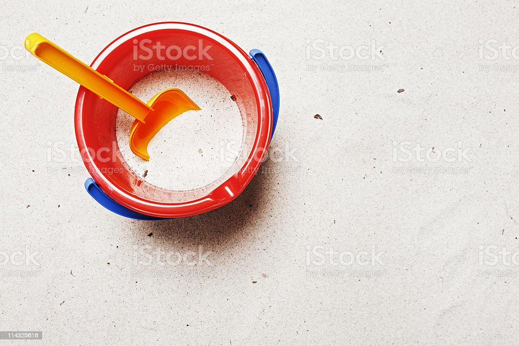 Child's pail and shovel with copy space | Beach background stock photo