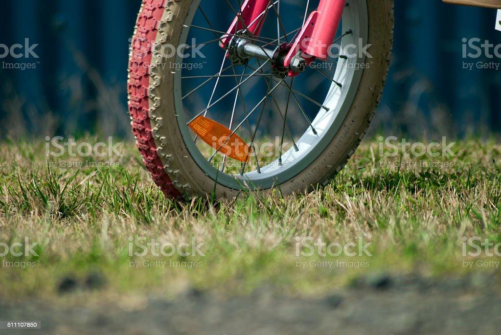 child's pink bicycle wheel stock photo