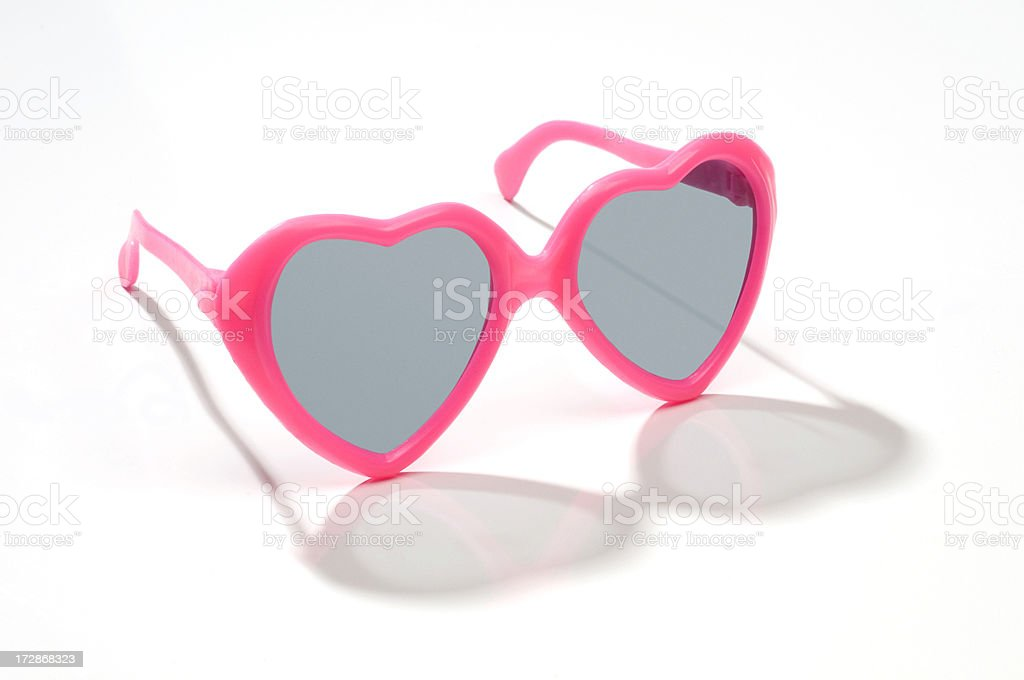 Child's pink heart shaped sunglasses-isolated on white stock photo