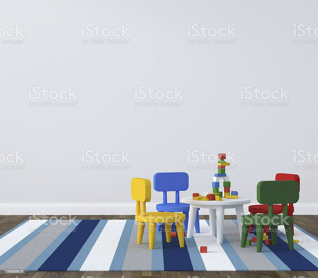 Childs play table on a striped rug in a simple room stock photo