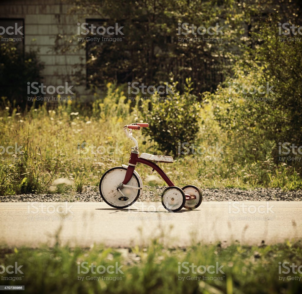 Child's Tricycle on Rural Road stock photo