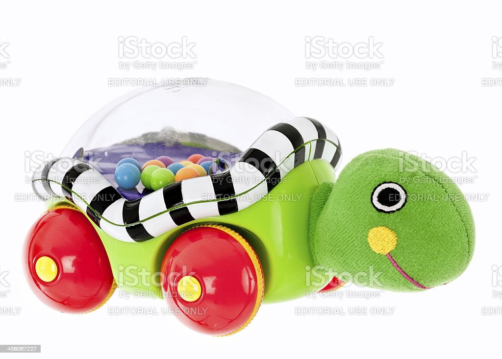 Childs wind up turle popping ball toy with wheels stock photo