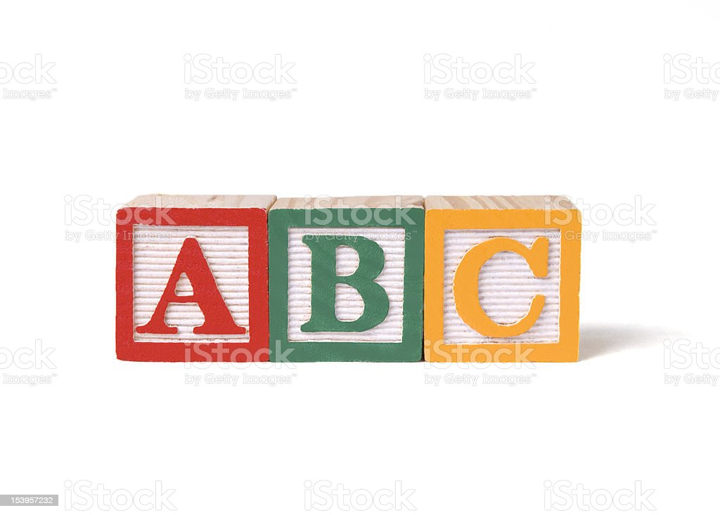 Child's wooden ABC alphabet blocks on white background stock photo