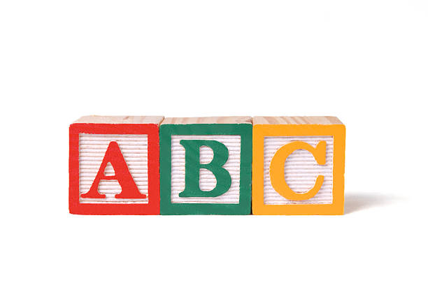 child's wooden abc alphabet blocks on white background - alphabetical order stock pictures, royalty-free photos & images