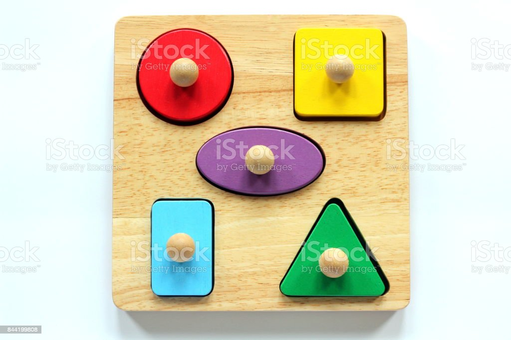 A child's wooden shape sorter jigsaw puzzle stock photo