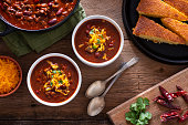 Bowls of Homemade Chili with Corn Bread, Cilantro and Cheddar Cheese