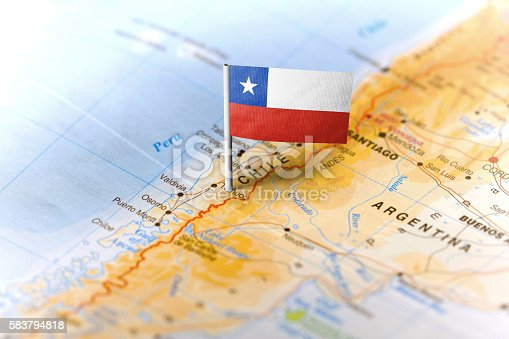 The flag of Chile pinned on the map. Horizontal orientation. Macro photography.