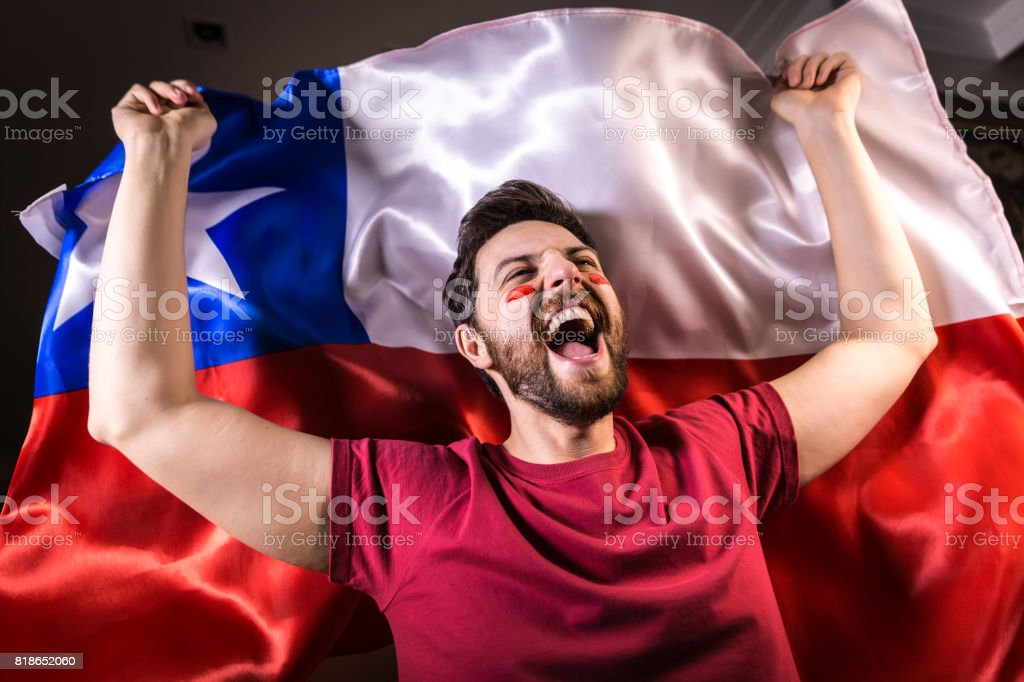 Chilean fan holding the national flag stock photo