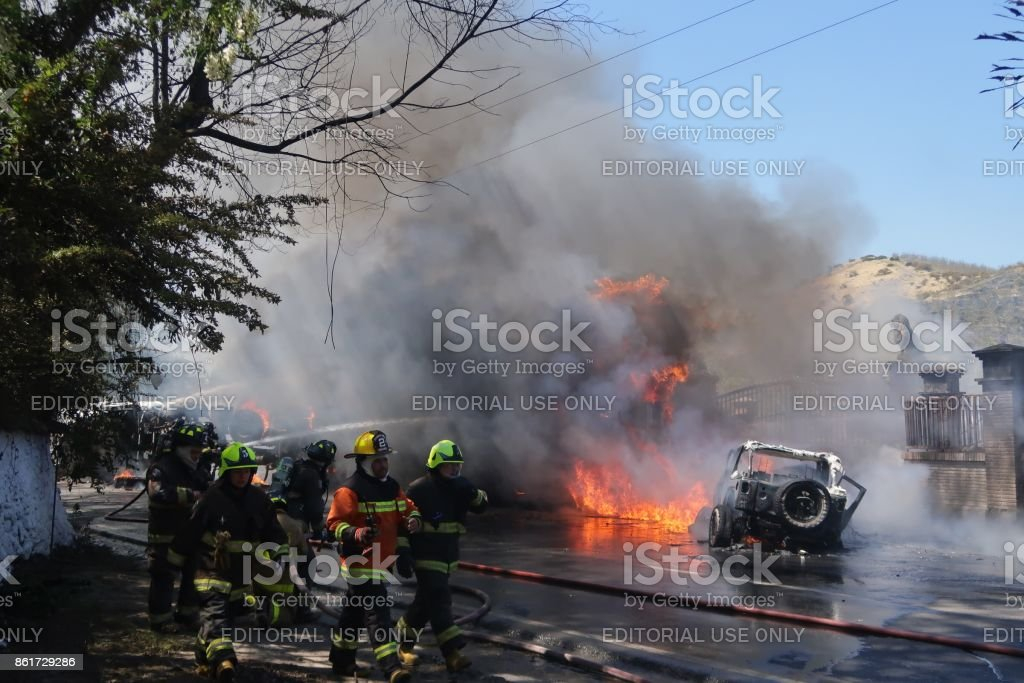 Chilean Firefighter In Action Car Accident Stock Photo