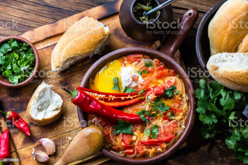 Chilean food. 'Picante Caliente' or 'spicy hot' with onion, tomatos, chilli aand eggs stock photo