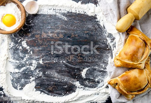istock Chilean independence day baking concept. fiestas patrias. Chilean typical EMPANADAS DE PINO for independence day party. 1021465688