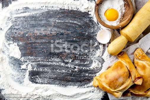 istock Chilean independence day baking concept. fiestas patrias. Chilean typical EMPANADAS DE PINO for independence day party. Copy space 1021465690