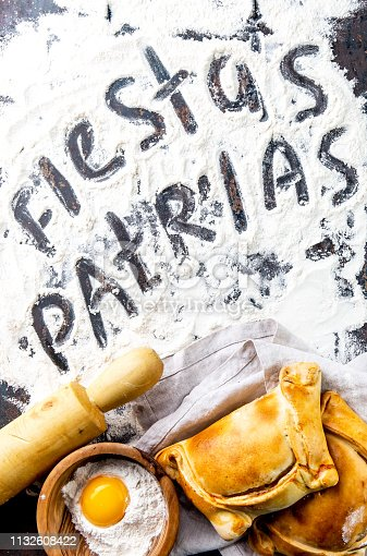 istock Chilean independence day baking concept. fiestas patrias. Chilean typical EMPANADAS DE PINO for independence day party. 1132608422