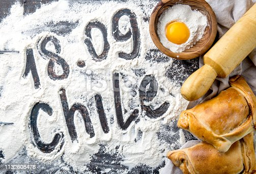 istock Chilean independence day baking concept. fiestas patrias. Chilean typical EMPANADAS DE PINO for independence day party. 1132608476