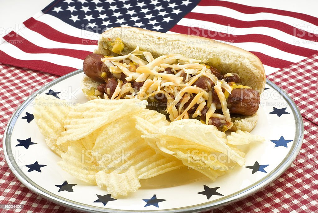 Chili and Cheese Hotdog with American Flag royalty-free stock photo