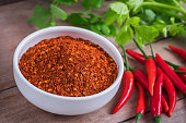 istock Chili cayenne in bowl and fresh chili on wooden table 637316180