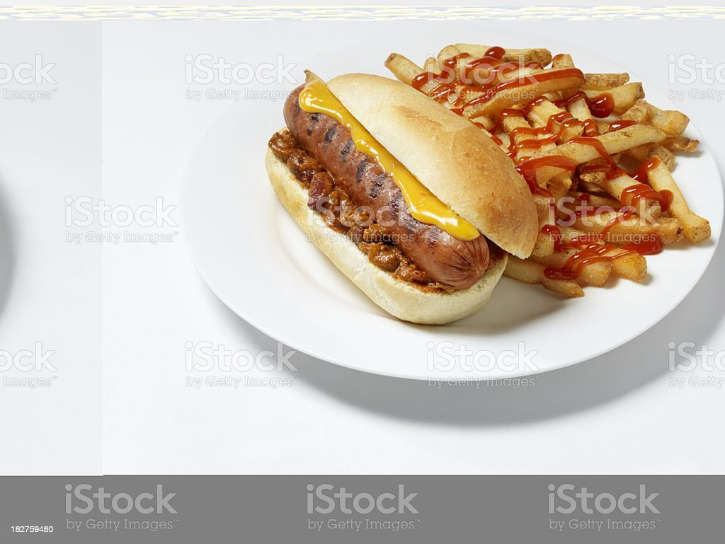 Chili Cheese Dog with Fries royalty-free stock photo