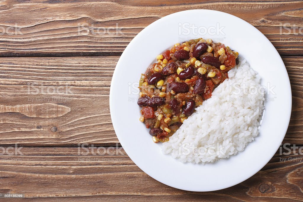 Chili con carne and rice on white plate top view stock photo