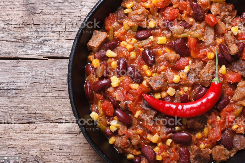 chili con carne close-up in a frying pan top view stock photo
