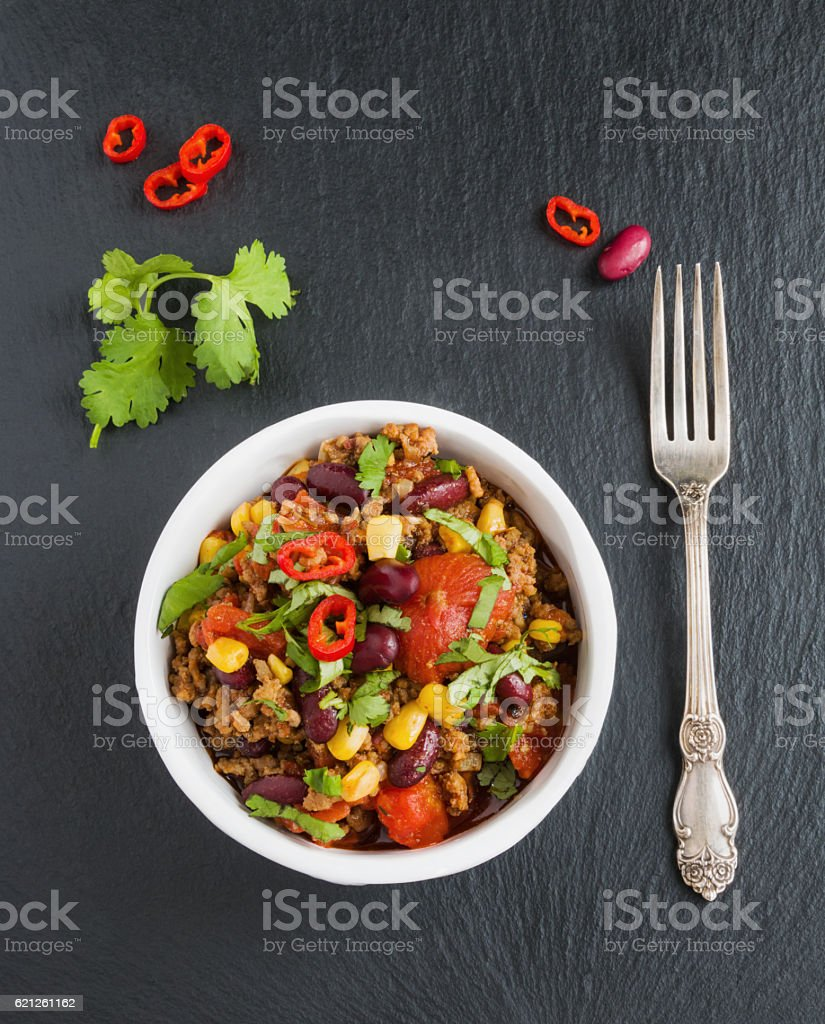 Chili con carne in a white ceramic bowl stock photo