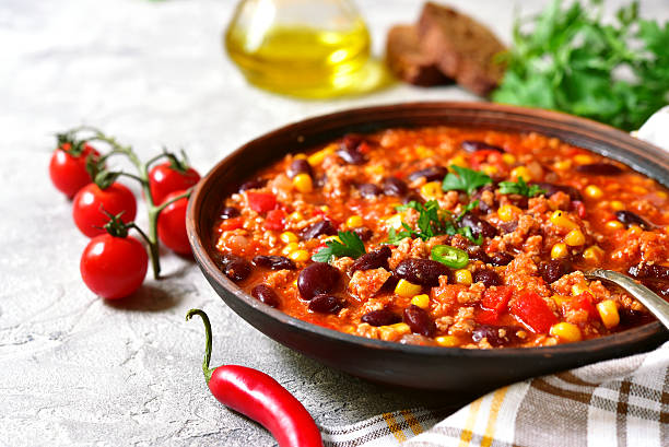 chili con carne - traditional dish of mexican cuisine. - chilli stock photos and pictures