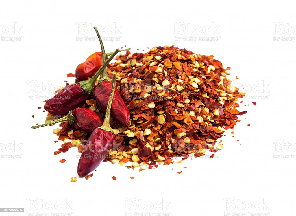 Chili flakes and peppers isolated stock photo