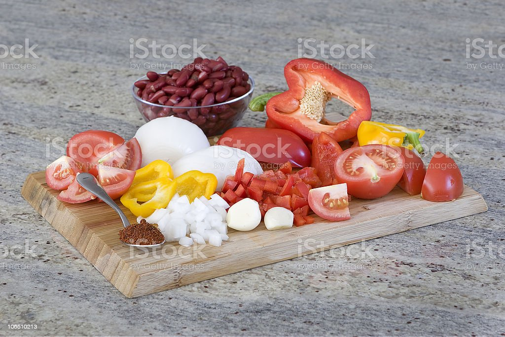 chili ingredients - chopped vegetables on a cutting board royalty-free stock photo
