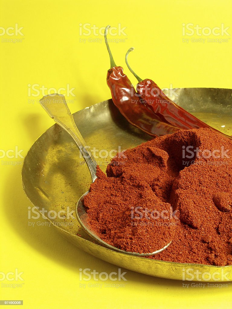 Chili on yellow background royalty-free stock photo