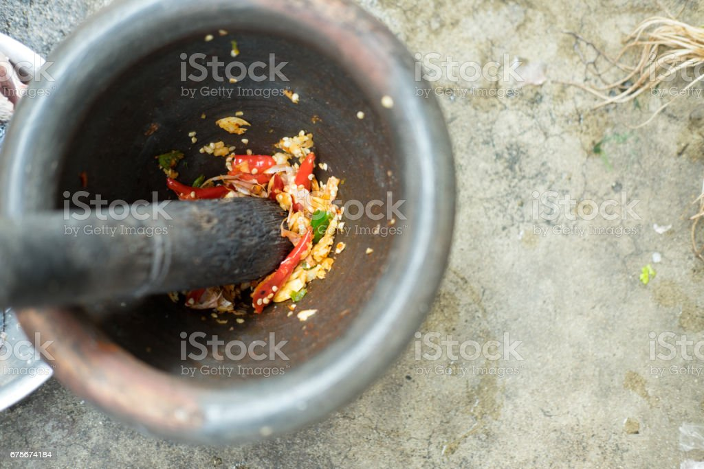 Chili pepper in wood mortar paste spicy herb ingredient food Thailand ancient style. foto de stock royalty-free