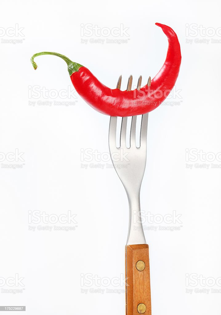 chili pepper on a fork royalty-free stock photo