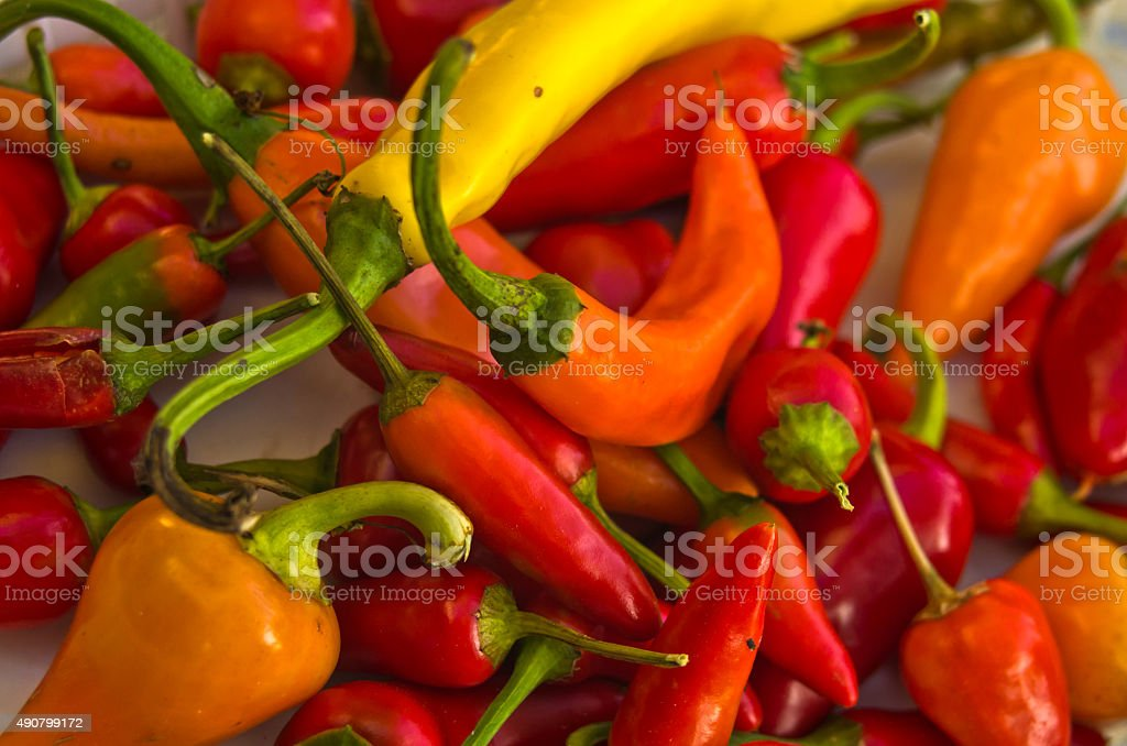 Chili peppers of different colors and flavours stock photo
