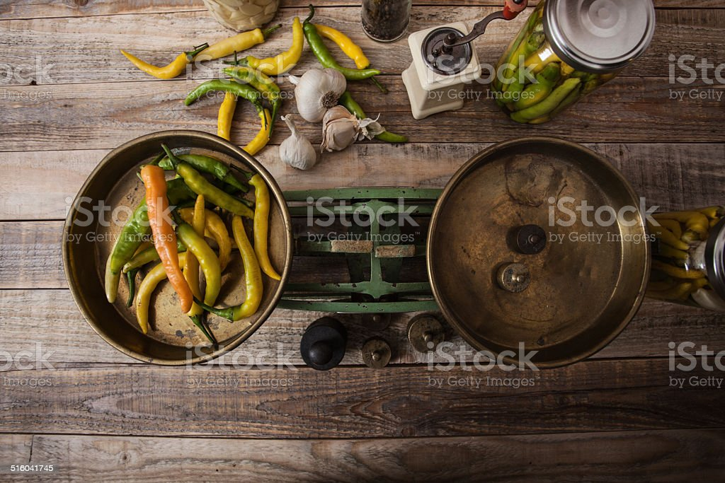 Chili peppers on old fashioned scale stock photo