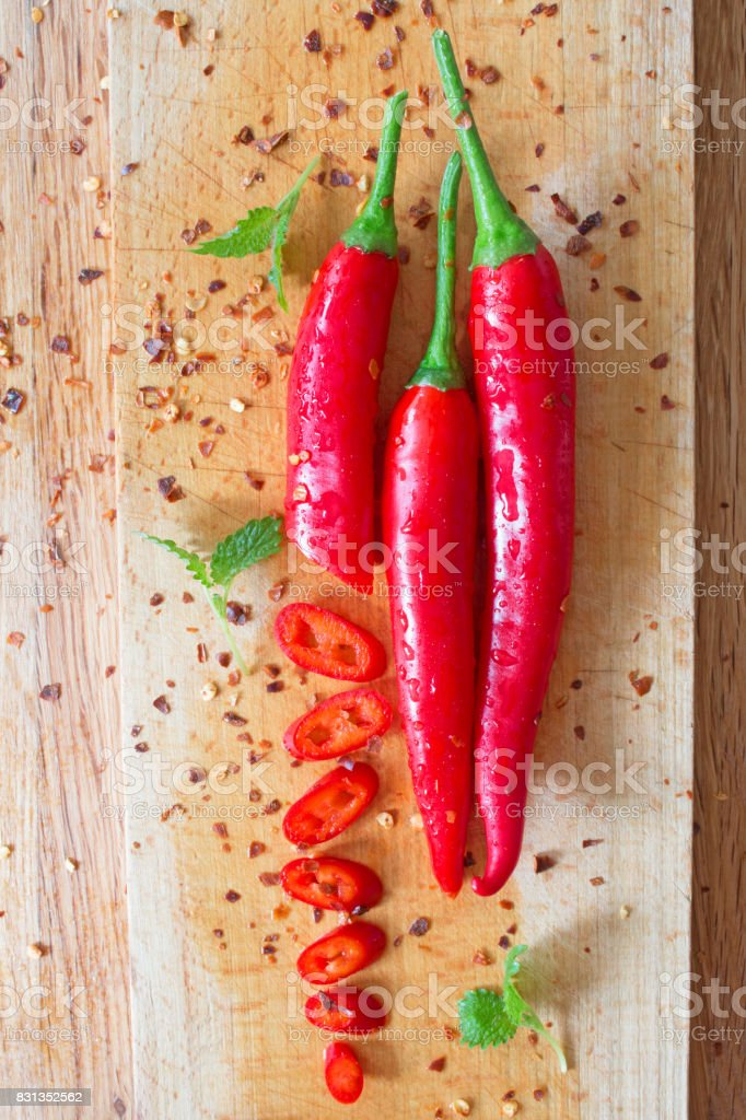 Chili peppers on wooden background stock photo