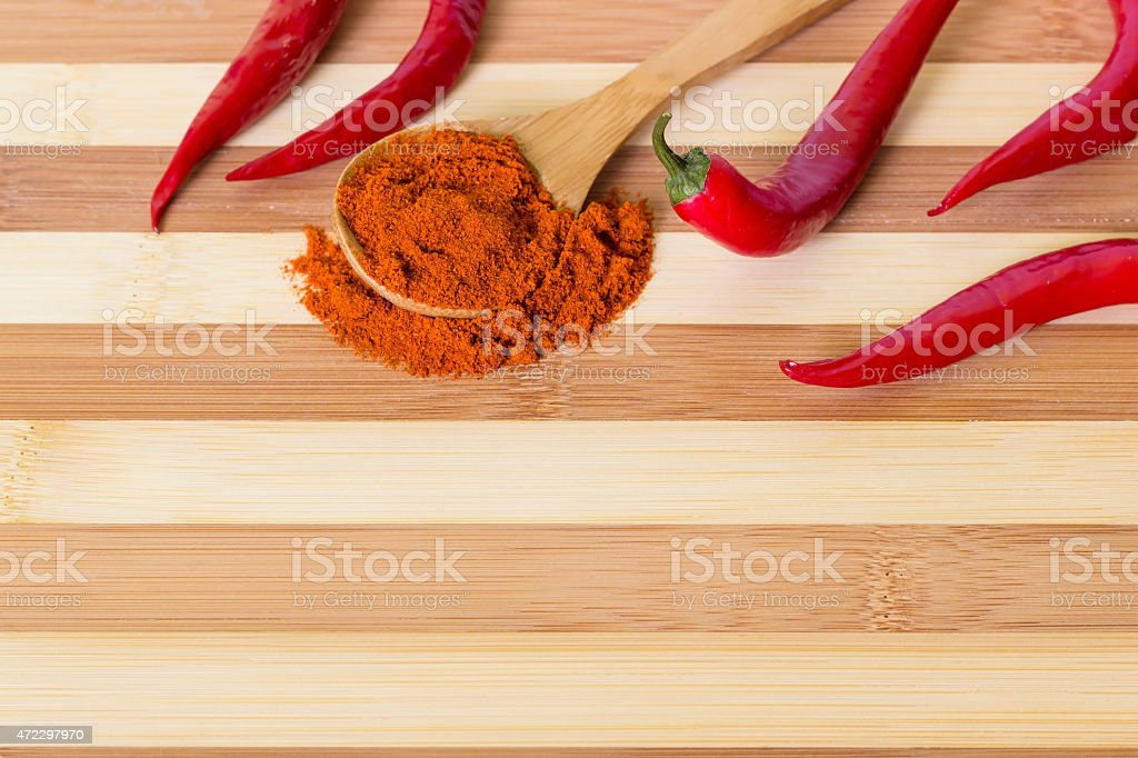 Chili powder and peppers stock photo