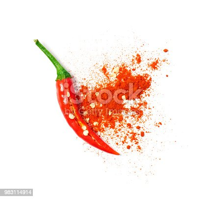 Chili powder spilled out of a cut open chili pepper