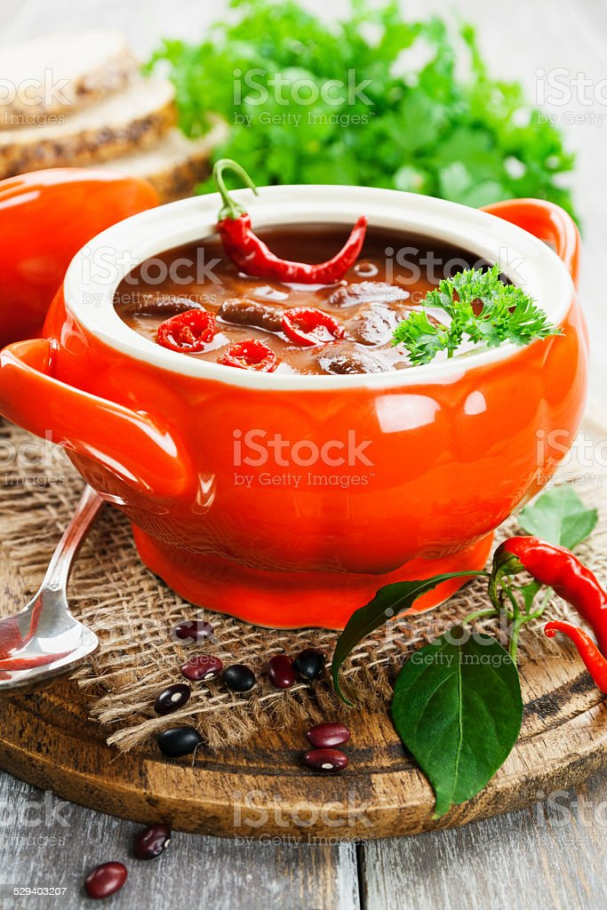 Chili soup with red beans and greens stock photo