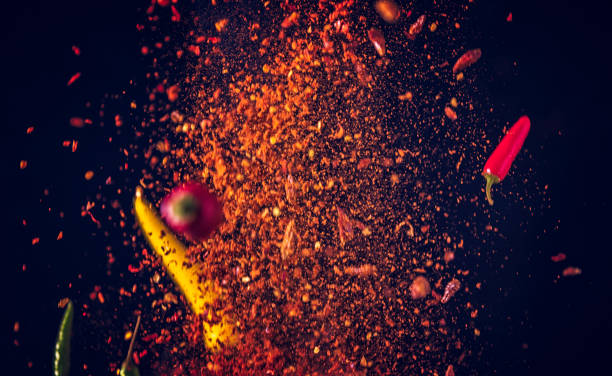 chili spice mix food explosion - pepper seasoning stock photos and pictures