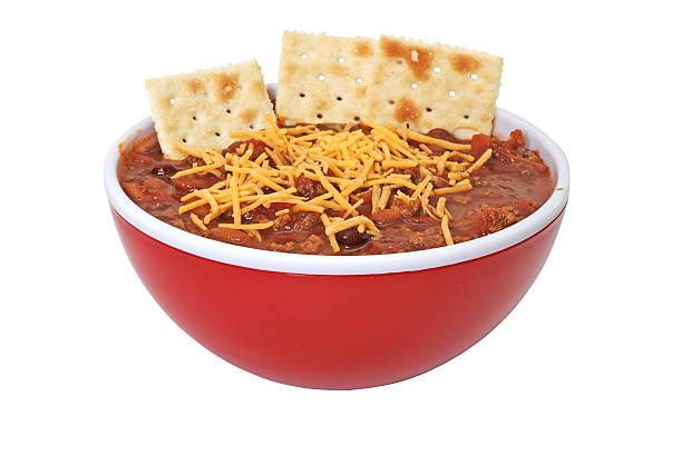 chili with cheese, beans, and crackers - chilli stock photos and pictures