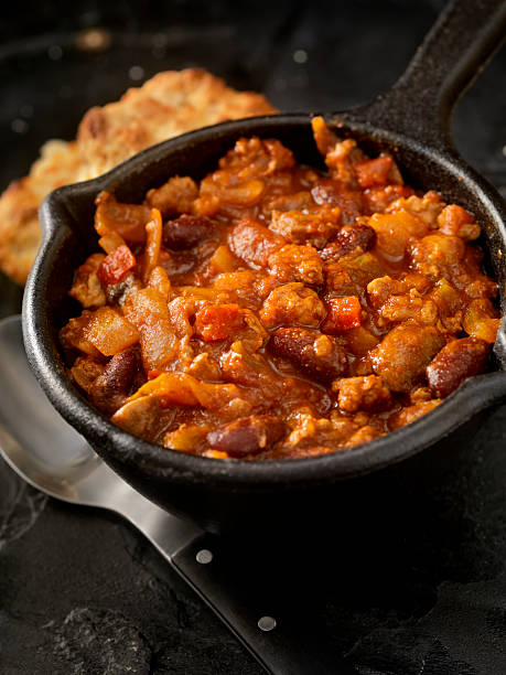chili with fresh biscuits - chilli stock photos and pictures