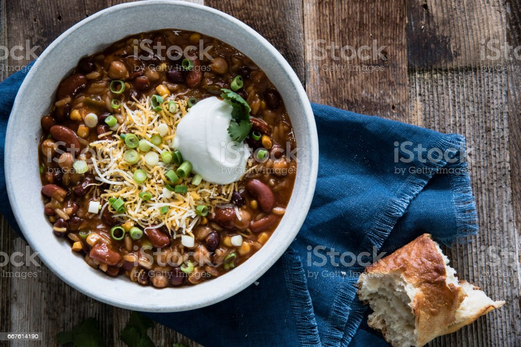Chili with Grated Cheese and Scallions stock photo