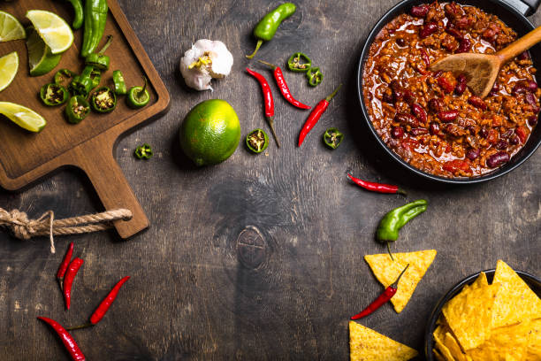 chili con carne background - chilli stock photos and pictures