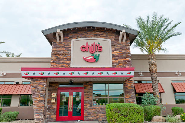 Chili's Casual Dining Restaurant  Store Front with Palm Tree stock photo