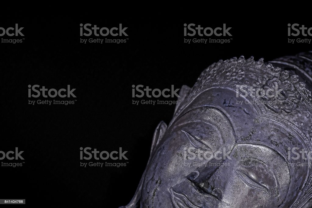 Chill out. Modern spirituality with buddhism. Silver sleeping buddha head with copy space. stock photo